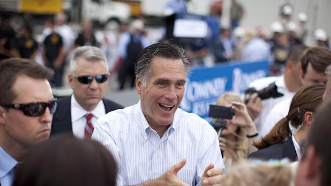 Republican presidential candidate, former Massachusetts Gov. Mitt Romney shakes hands during a campaign event at Watson Truck and Supply, Thursday, Aug. 23, 2012, in Hobbs, N.M.  (AP Photo/Evan Vucci)
