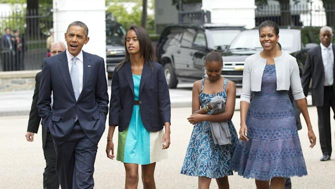 President Barack Obama, left, with first lady Michelle Obama, right, and their daughters Sasha and Malia, second from left, walk from the White House in Washington to a nearby church to attend services Sunday, Aug. 19, 2012.  (AP Photo/Manuel Balce Ceneta)