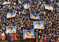 School children wave as they hold posters of Sachin Tendulkar at an event to honour him inside a school in Chennai November 14, 2013. REUTERS/Babu