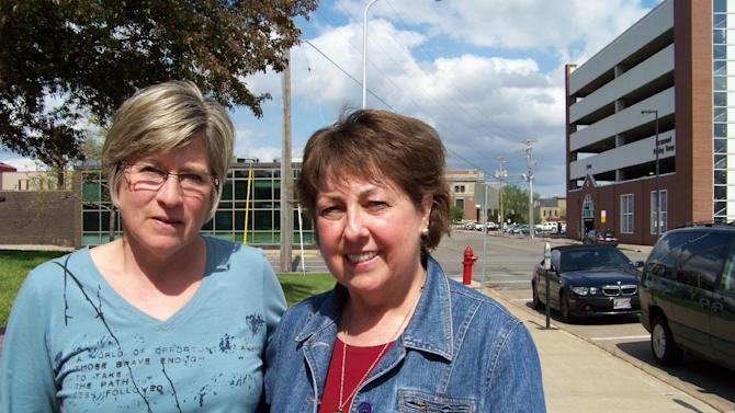 In this May 7, 2012, photo, Jean Jacobs, left, and Patty Klang pose for a photo in downtown St. Cloud, Minn. at the site of a 1998 gas explosion that killed their husbands. An Associated Press investigation has found since 1968, there have been at least 270 natural gas accidents in the U.S. that could have been prevented or made less dangerous by an inexpensive valve that cuts off leaking gas. At least 67 people have been killed and more than 350 hurt. Yet nearly 90 percent of the nation's gas service lines aren't fitted with the valves. (AP Photo/Amy Forliti.)