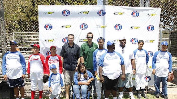 """COMMERCIAL IMAGE - Jared """"the SUBWAY guy"""" and baseball All-Star Aaron Boone coach the SUBWAY National Little League Appreciation Game for the Challenger Division as they launch the national """"Buddy Badge"""" program on Wednesday, June 27, 2012 in Los Angeles. (Photo by Joe Kohen/Invision for Subway/AP Images)"""
