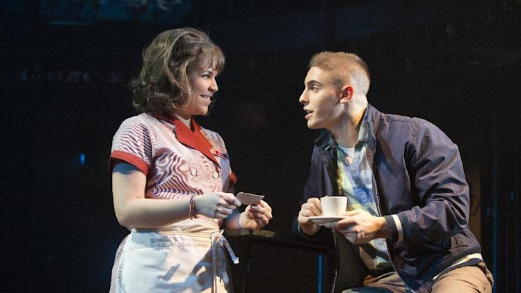 "This theater image released by The Hartman Group shows Lindsay Mendez, left, and Derek Klena in a scene from ""Dogfight,"" performing at the Second Stage Theatre in New York. (AP Photo.The Hartman Group, Joan Marcus)"
