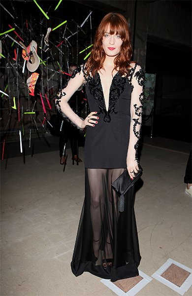 At a gala in London in late June, Florence slipped into a Julien Macdonald gown with a sheer skirt, black glass beading on nude sleeves and a plunging neckline. The only color came from her hair, lips