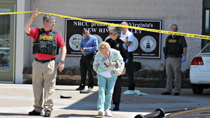 People are evacuated from the New River Valley Mall, Friday, April 12, 2013, after police responded to shots fired in Christiansburg, Va. A man shot and injured two women. One of the victims was airlifted to a hospital. The other victim was taken by ambulance for treatment. (AP Photo/The Roanoke Times, Mike Shaw) LOCAL TV OUT; SALEM TIMES REGISTER OUT; FINCASTLE HERALD OUT; CHRISTIANBURG NEWS MESSENGER OUT; RADFORD NEWS JOURNAL OUT; ROANOKE STAR SENTINEL OUT.