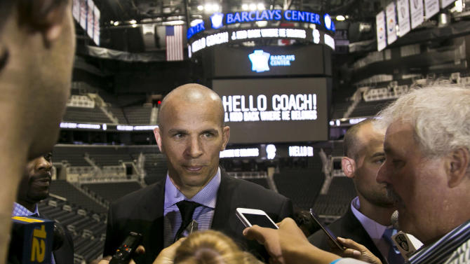 Brooklyn Nets new head coach Jason Kidd meets with reporters after he was introduced at an NBA basketball news conference Thursday, June 13, 2013, in  New York.   (AP Photo/Bebeto Matthews)