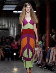 A model wears a design from the Mochino Cheap And Chic Spring/Summer 2013 collection during London Fashion Week, Saturday, Sept. 15, 2012. (AP Photo/Jonathan Short)
