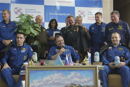 Russian cosmonauts Misurkin and Vinogradov and US astronaut Cassidy attend a press conference in Karaganda