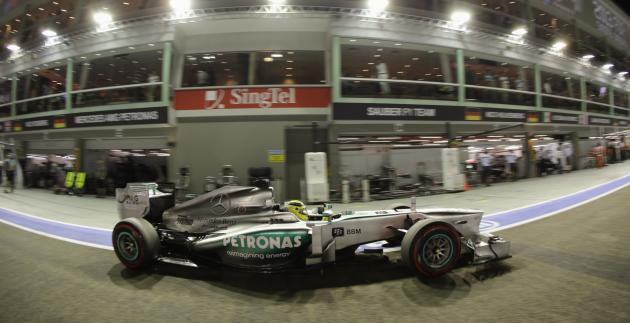 Mercedes Formula One driver Rosberg drives in the pit lane during the qualifying session of the Singapore Formula One Grand Prix
