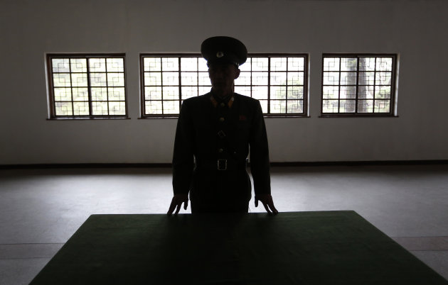 A North Korean military officer talks the history at a museum hall at Demilitarized Zone that separates the two Koreas in Panmunjom, North Korea Monday, April 23, 2012. North Korea promised Monday to reduce South Korea&#39;s conservative government &quot;to ashes&quot; in less than four minutes, in an unusually specific escalation of recent threats aimed at its southern rival. The statement by North Korea&#39;s military, carried by state media, comes amid rising tensions on the Korean peninsula. Both Koreas recently unveiled new missiles, and the North unsuccessfully launched a long-range rocket earlier this month. (AP Photo/Vincent Yu)