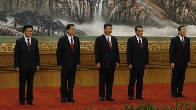New members of the Politburo Standing Committee, from left, Zhang Gaoli, Liu Yunshan, Zhang Dejiang, Xi Jinping, Li Keqiang, Yu Zhengsheng and Wang Qishan stand together at Beijing's Great Hall of the People Thursday Nov. 15, 2012. The seven-member Standing Committee, the inner circle of Chinese political power, was paraded in front of assembled media on the first day following the end of the 18th Communist Party Congress. (AP Photo/Vincent Yu)