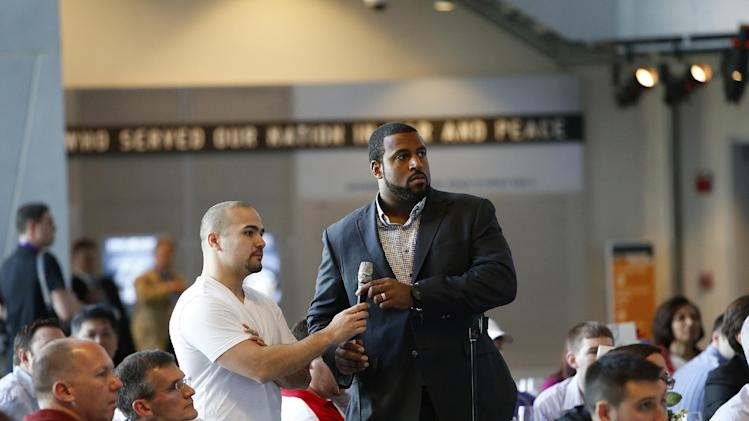 Houston Texans left tackle Duane Brown, right, serves as an NFLPA field reporter during the NFLPA Legends Brunch at the National World War II Memorial Museum on Sunday February 3, 2013 in New Orleans, Louisiana. (Aaron M. Sprecher/AP Images for NFLPA)