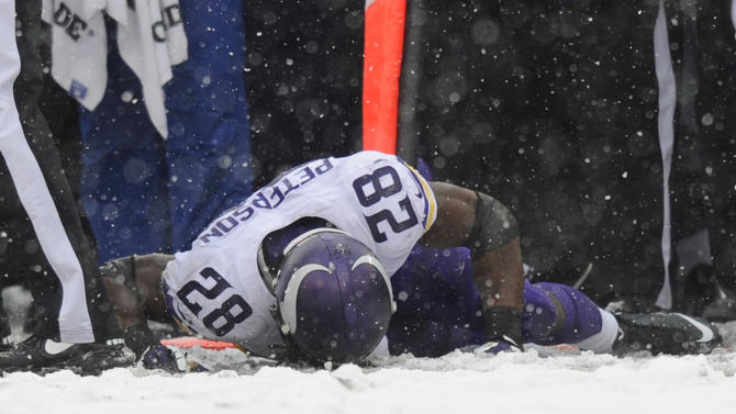Minnesota Vikings running back Adrian Peterson lies on the field after injuring himself on a play in the first half of an NFL football game against the Baltimore Ravens, Sunday, Dec. 8, 2013, in Baltimore. (AP Photo/Nick Wass)