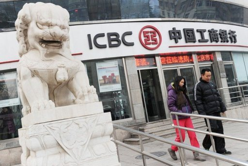 <p>Customers leave an ICBC branch in Beijing. The Industrial and Commercial Bank of China, the country's biggest lender by assets, said Thursday its first-half net profit rose 12.5 percent from a year earlier on growth in interest and fee income.</p>