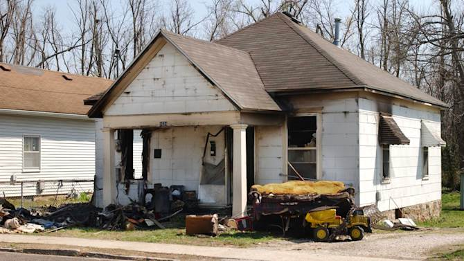 This 2008 photo shows a house in Springfield, Mo., where prosecutors said Jeffrey Allen Dickson left his victim, a 7-year-old girl, to die after setting it ablaze to cover up his crime. The girl survived and a Springfield jury quickly found Dickson guilty of child kidnapping, forcible rape and forcible sodomy in the April 5, 2008 attack. But new evidence unearthed by Dickson's state-appointed appeals court lawyer and reviewed as part of a five-month Associated Press investigation suggests that a rush to judgment could have caused police and prosecutors to target the wrong man. He is scheduled to argue his appeal on Tuesday and Wednesday, Oct. 10, 2012, in Springfield, Mo. (AP Photo/The Springfield News-Leader, Steve J.P.Liang)