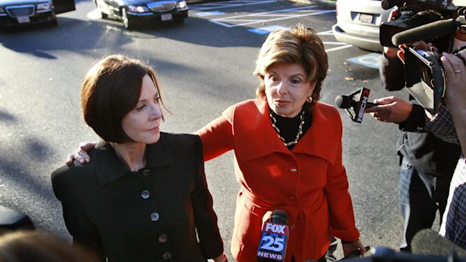 Maureen Stemberg Sullivan, left, ex-wife of Staples founder Tom Stemberg, and her lawyer Gloria Allred, right, face members of the media as they arrive at Norfolk County Probate Court Thursday, Oct. 25, 2012, in Canton, Mass. Lawyers for The Boston Globe are to return to court Thursday to argue for the public release of testimony given by GOP presidential candidate Mitt Romney in the divorce of Stemberg. Stemberg's ex-wife and Allred and told the judge in the case they do not object to lifting the impoundment order on Romney's testimony. (AP Photo/Steven Senne)