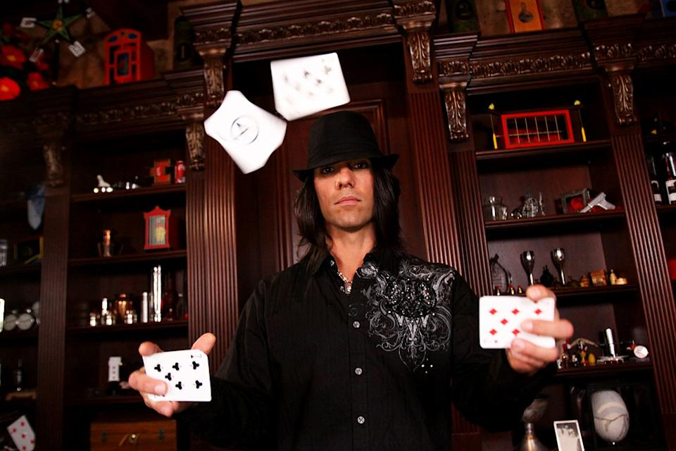 "Criss Angel with cards in the air during the filming of season six of ""Criss Angel Mindfreak."""