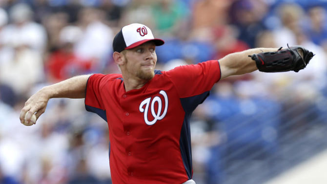 Washington Nationals pitcher Stephen Strasburg throws a pitch during the first inning of an exhibition spring training baseball game in Port St. Lucie, Fla., Saturday, Feb. 23, 2013, in (AP Photo/Julio Cortez)