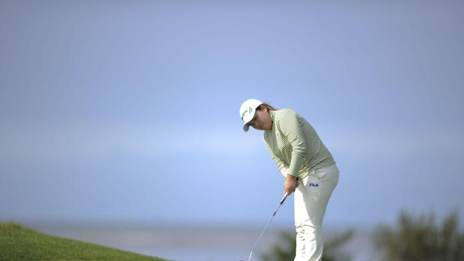Korea's Inbee Park putts during the delayed second round of play on day three of the Women's British Open at the Royal Liverpool Golf Club, Hoylake, north western England, Saturday Sept. 15, 2012. (AP Photo/PA, Jon Buckle) UNITED KINGDOM OUT  NO SALES  NO ARCHIVE