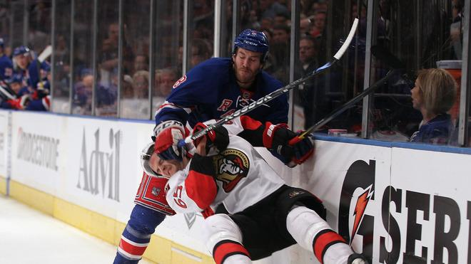 Erik Karlsson #65 Of The Ottawa Senators Is Checked By Brandon Prust #8 Of The New York Rangers In Game Two Of The Getty Images