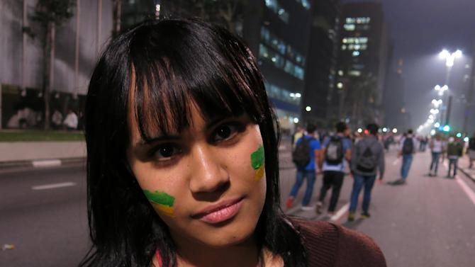 "Erika Ribeira poses for a photo at an anti-government protest in Sao Paulo, Brazil, Thursday, June 20, 2013. The 17-year-old student says, ""We must invest in education before we invest so much money in the World Cup. We need schools, not stadiums."" (AP Photo/Bradley Brooks)"