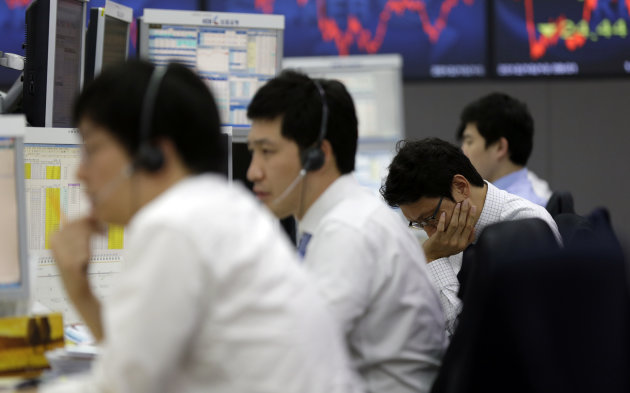 Currency traders work at the foreign exchange dealing room of the Korea Exchange Bank headquarters in Seoul, South Korea, Wednesday, Oct. 10, 2012. Worries about Europe&#39;s debt crisis, signs of weak global growth and expectations of lower U.S. corporate earnings sent most Asian stock markets down Wednesday. South Korea&#39;s Kospi dropped 1.4 percent at 1,955.84. (AP Photo/Lee Jin-man)