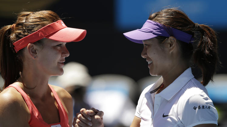 China's Li Na, right, is congratulated by Poland's Agnieszka Radwanska following their quarterfinal match at the Australian Open tennis championship in Melbourne, Australia, Tuesday, Jan. 22, 2013. (AP Photo/Andy Wong)