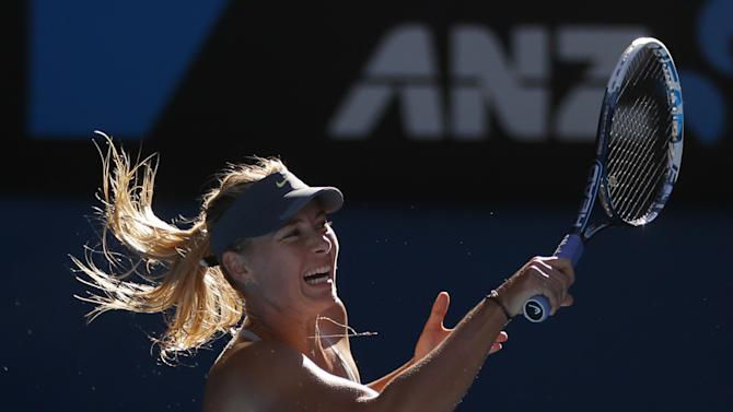 Russia's Maria Sharapova hits a return to compatriot Ekaterina Makarova during their quarterfinal match at the Australian Open tennis championship in Melbourne, Australia, Tuesday, Jan. 22, 2013. (AP Photo/Dita Alangkara)