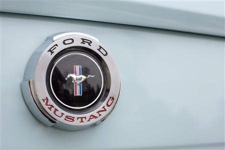 A Mustang badge is seen on Gail Wise's Skylight Blue 1964 1/2 Ford Mustang in Park Ridge
