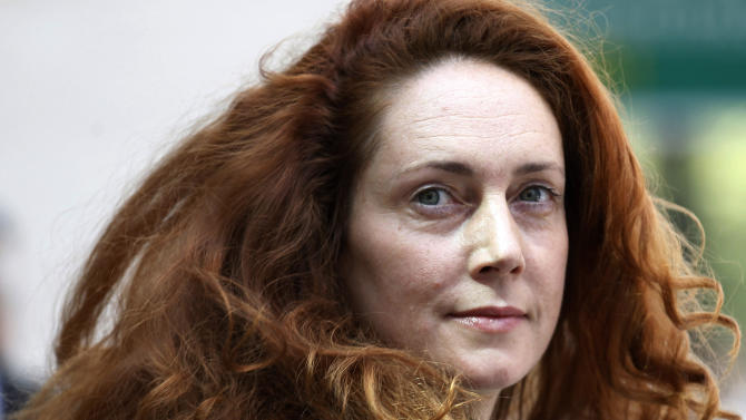 FILE This Wednesday, June 13, 2012 file photo shows Rebekah Brooks, former chief executive of News International, leaving Westminster Magistrates' Courts after she was granted bail on charges of attempting to cover up tabloid phone-hacking, London. British authorities on Tuesday July 24, 2012 charged an ex-aide to the British prime minister, a former protege of media mogul Rupert Murdoch and six others in the ever-widening phone hacking scandal, accusing them of key roles in a lengthy campaign of illegal espionage that victimized hundreds including top celebrities Angelina Jolie and Brad Pitt. The Crown Prosecution Service's Alison Levitt told journalists that Andy Coulson and Rebekah Brooks, both former editors of Murdoch's now-shuttered News of the World tabloid, are among those being charged with conspiring to intercept the communications of more than 600 people between Oct. 3, 2000, and Aug. 9, 2006(AP Photo/Sang Tan)