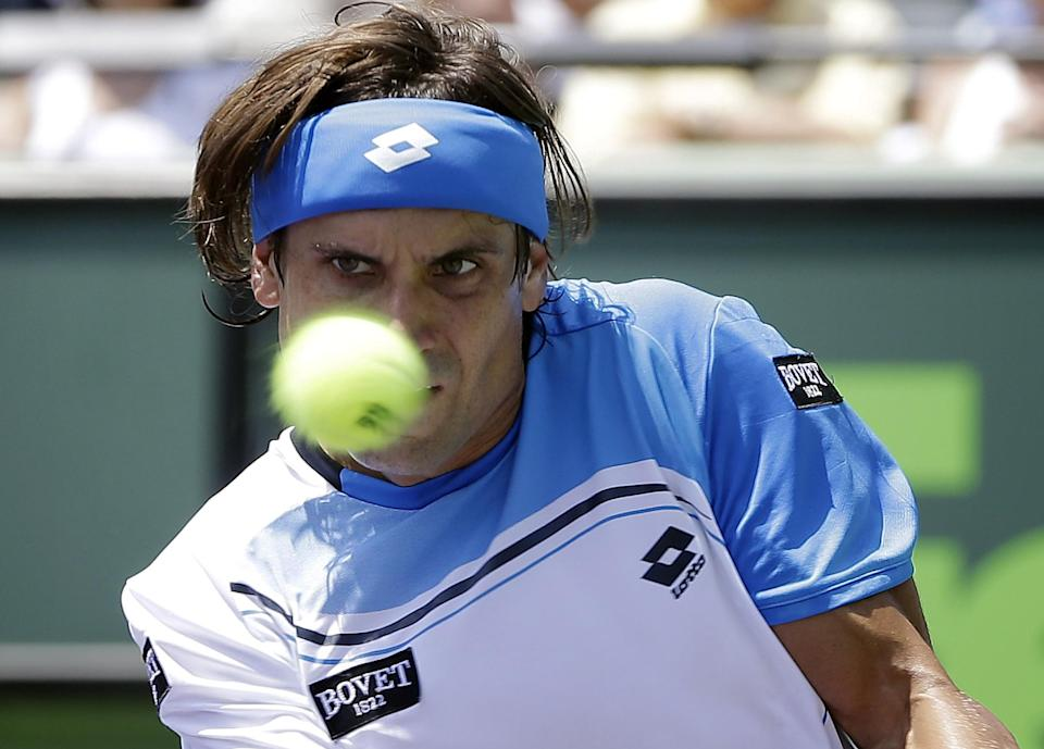David Ferrer, of Spain, returns the ball to Andy Murray, of Britain, during the Sony Open Tennis Tournament in Key Biscayne, Fla., Sunday, March 31, 2013. Murray won 2-6, 6-4, 7-6 (1). (AP Photo/J Pat Carter)