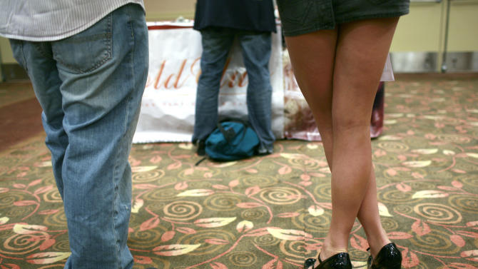People wait in line to speak with recruiting representatives during a job fair in San Francisco