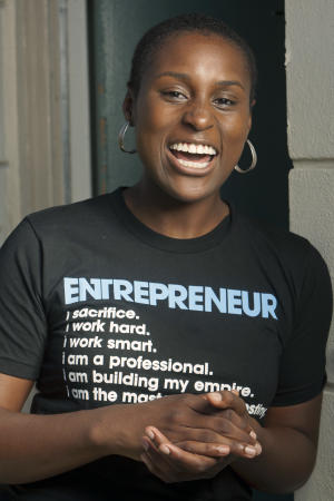 "Producer, director and writer Issa Rae, creator of the YouTube series ""The Misadventures of Awkward Black Girl,"" poses for a photo at her home Wednesday, Sept. 7, 2011, in Los Angeles. Since the series first posted online in February, the debut episode has garnered more than 240,000 hits. Subsequent episodes have received more than 100,000 hits and 1,000 viewer comments. (AP Photo/Damian Dovarganes)"