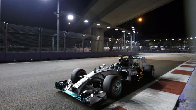 Mercedes Formula One driver Rosberg of Germany drives during the qualifying session of the Singapore F1 Grand Prix at the Marina Bay street circuit in Singapore