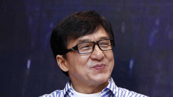 "FILE - This Dec. 18, 2013 file photo shows Hong Kong actor Jackie Chan smiles during a press conference to promote his new film ""Police Story 2013"" in Kuala Lumpur, Malaysia. Chan is transforming himself from action film superstar to K-pop band manager. Sha-sha Lee, CEO of the Jackie Chan Group South Korea, said Chan was involved in auditioning the band members for JJCC and will manage the group personally. The group plans to release its debut album March 24 in South Korea, before promoting it in China. (AP Photo/Lai Seng Sin, File)"