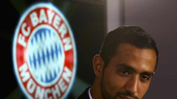 Bayern Munich's new player Benatia attends a news conference at Bayern Munich's headquarters in Munich