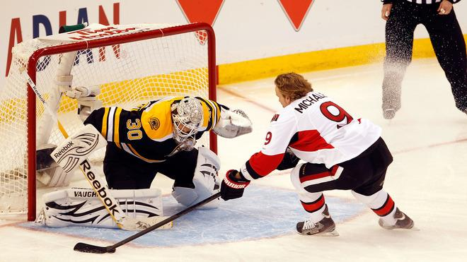 Milan Michalek #9 Of The Ottawa Senators And Team Alfredsson Takes A Shot On Tim Thomas #30 Of The Boston Bruins And Getty Images