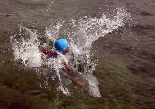 U.S. swimmer Diana Nyad starts her swim after jumping into the water off the coast of Havana, Cuba, Saturday, Aug. 18, 2012. Endurance athlete Nyad launched another bid Saturday to set an open-water r