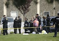 Police officers clear the scene at a private religious college in Oakland, California on April 2. A Korean-American former student at a California religious college lined up his victims and shot them them execution-style, police said Tuesday