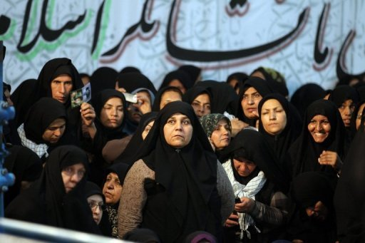 Iranian women listen to a speech by President Mahmoud Ahmadinejad at Ayatollah Ruhollah Khomeini&#39;s mausoleum in Tehran last week. Women in Iran are being banned from watching live public screenings of Euro 2012 football games because of an &quot;inappropriate&quot; environment where men could become rowdy, a deputy police commander said Sunday