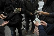 <p>Street money changers exchange US dollar notes in Lima on September 6. Counterfeiting has grown large and fast enough that US authorities call Peru one of Latin America's worst offenders when it comes to cranking out fake US currency.</p>