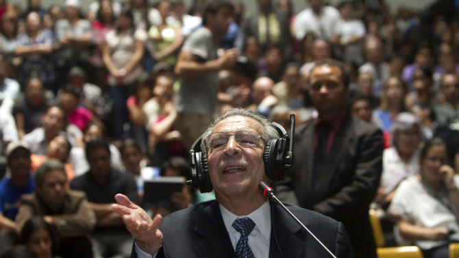 "Guatemala's former dictator Jose Efrain Rios Montt speaks during his genocide trial in Guatemala City, Thursday, May 9, 2013. The 86-year-old ex-general says he never ordered attacks against ""a race,""denying he ordered the extermination of Ixil Mayas. Prosecutors say that while in power, Rios Montt was aware of, and thus responsible for, the slaughter of at least 1,771 Ixil Mayas in the towns of San Juan Cotzal, San Gaspar Chajul and Santa Maria Nebaj in Guatemala's western highlands. (AP Photo/Moises Castillo)"