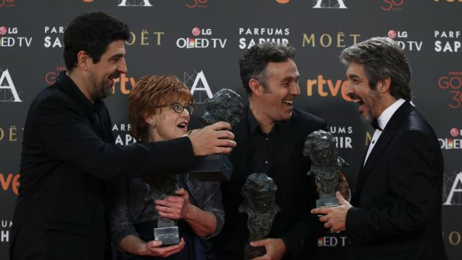 "Director Gay, producer Esteban, screenplay writer Aragay and actor Darin hold their trophies for the film ""Truman"" during the Spanish Film Academy's Goya Awards ceremony in Madrid"