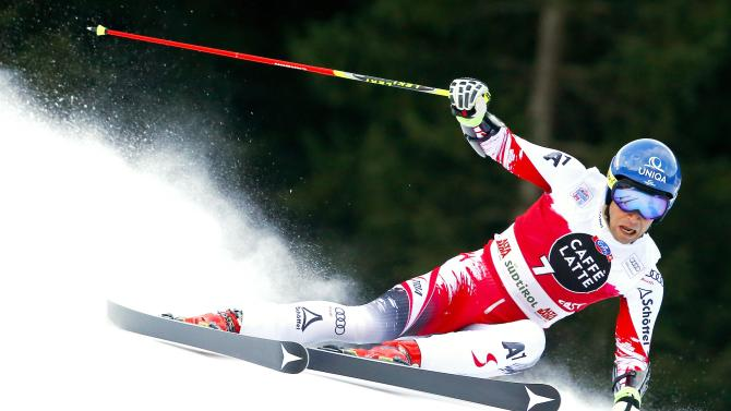 Raich of Austria clears a gate during the men's World Cup Giant Slalom skiing race in Alta Badia