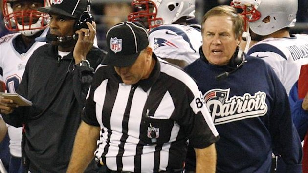 New England Patriots head coach Bill Belichick (R) complains to an official during the first half of their NFL football game against the Baltimore Ravens in Baltimore, Maryland, September 23, 2012.