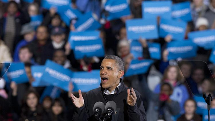 In the final hours of a four-state campaign day, President Barack Obama speaks at a rally at Jiffy Lube Live arena, late Saturday night, Nov. 3, 2012, in Bristow, Va. Virginia is one of the most closely contested battleground states.  (AP Photo/J. Scott Applewhite)