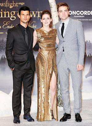 Kristen Stewart Flashes Major Leg in Sexy Golden Gown at Berlin Breaking Dawn Screening