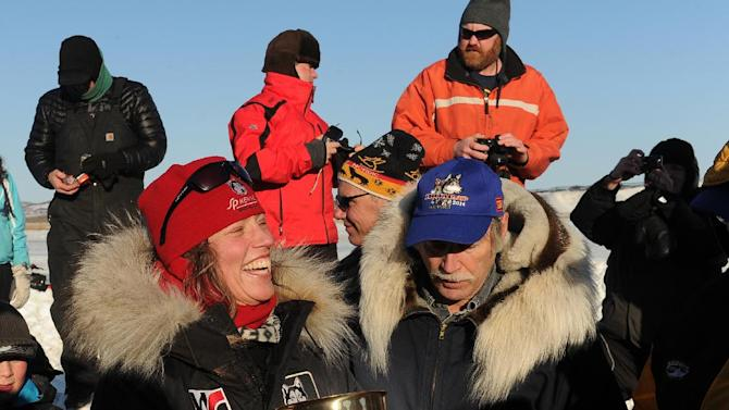 Aliy Zirkle accepts the Wells Fargo Gold Coast Award for the first musher to reach the Bering Sea in Unalakleet during the 2014 Iditarod Trail Sled Dog Race on Saturday, March 8, 2014. (AP Photo/The Anchorage Daily News, Bob Hallinen)