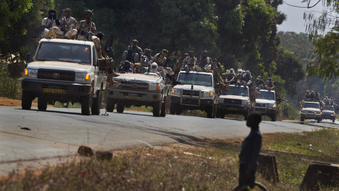 FILE - In this Jan. 2, 2013 file photo, a convoy of Chadian soldiers fighting in support of Central African Republic president Francois Bozize moves along the road in Damara, about 70km (44 miles) north of the capital Bangui, Central African Republic Wednesday, Jan. 2, 2013. On Friday, March 22, rebels took the town of Damara, beginning a new march to take the capital, Bangui, said a rebel spokesman. Panic spread throughout the capital, with the neighborhoods closest to the northern gate of the city emptying out, as frightened residents locked up their shops, packed their bags and yanked their children out of school. Banks and government offices closed early.(AP Photo/Ben Curtis, File)