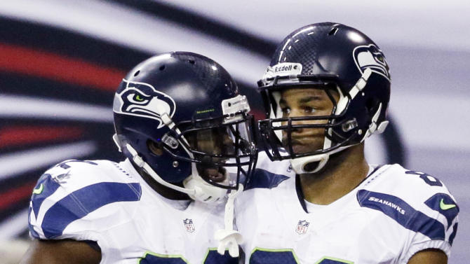 Seattle Seahawks wide receiver Golden Tate (81) speaks with Seattle Seahawks running back Robert Turbin (22) after Tate scored a touchdown during the second half of an NFC divisional playoff NFL football game against the Atlanta Falcons Sunday, Jan. 13, 2013, in Atlanta. (AP Photo/David Goldman)