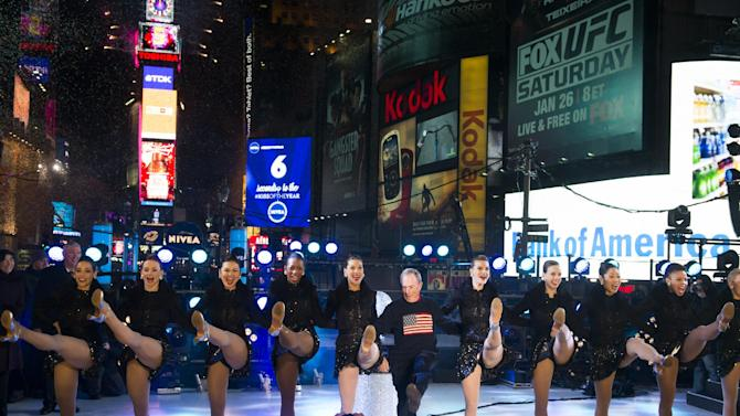 New York Mayor Michael Bloomberg dances with the Radio City Rockettes in Times Square during New Year's celebrations on Tuesday, Jan. 1, 2013 in New York. (Photo by Charles Sykes/Invision/AP)